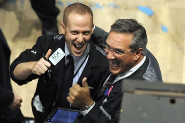 Traders cheering